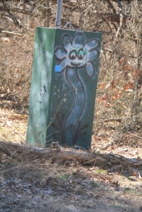 Look out for grafittied electric box.