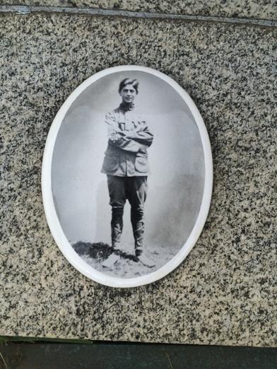 Picture on the gravestone.