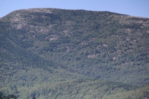 People on Cadiallac Mountain admiring the view of us.