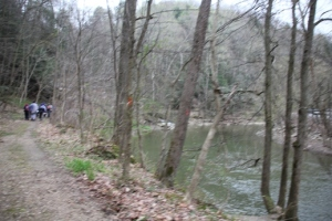 Following the bank of the creek.