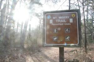 The Mt. Misery Trailhead will be on your right side.