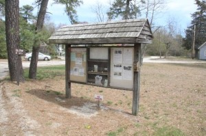 Go to the big info sign to the right of the general store.