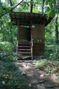 Elevated outhouse.