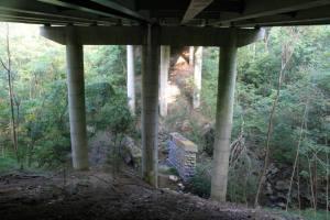 Old bridge under a new one.
