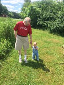 Granddad walking with Tree Rider. The little guy made it about a hundred yard, his longest hike to date!